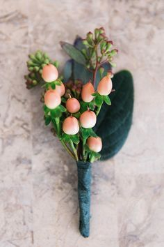Coral berry boutonniere | Read More: www.stylemepretty... | Photography: K And K Photography - kandkphotography.com