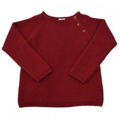 Ce joli pull en maille est tricoté au point mousse dans une jauge de cotonqui lui donne à la fois légéreté et élégance. Parfait pour garçons et filles, la couleur bordeaux est lumineuse pour l'hiver.