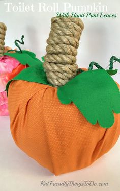 How To Make A Toilet Paper Roll Pumpkin With Hand Print Leaves - A sweet simple keepsake pumpkin for fall crafts or Thanksgiving - http://KidFriendlyThingsToDo.com
