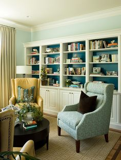 color of back of book cases a few shades darker than the wall color to highlight them Lisa Levin Interiors