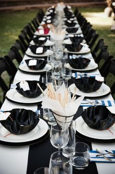 black and white long tables with homemade bowls from old records given as party favors -an idea if it fits her