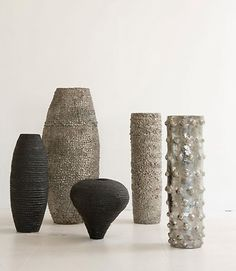 Vessels by ceramic artist Abigail Simpson (b.1964). l-r: Graphite Pitted Vessel, 34 in; Large Platinum Coin Vessel, 56 in; Graphite Pitted Heart Vessel, 20 in; Platinum Scrunch Vessel, 54in; Platinum Bobble Pot, 54 in. via Ralph Pucci