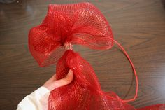 """Unique  mesh ribbon Christmas wreath. Wire clothes hanger, 21"""" deco mesh, and tape. Measure out 8"""" per poof."""
