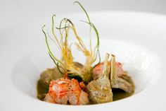 """A starter of """"gambas y alcachofas"""" or shrimp with artichokes three ways. Ms. Ruscalleda specializes in seafood from the Mediterranean."""