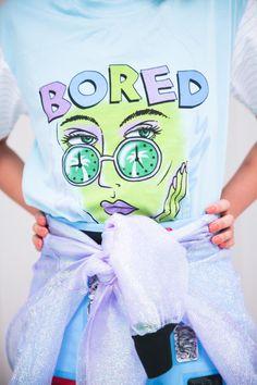Style Bubble, Emma Mulholland Bored t-shirt, Emma Mulholland x Pared sunglasses, Toga skirt, Bubbles Tokyo iridescent jacket around waist, Emma Mulholland sequin socks, Mother of Pearl slip-ons