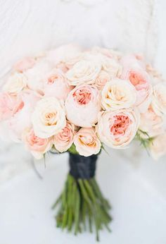 a bouquet of blush pink garden roses and spray roses.