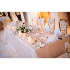 Luxurious linens, candles, roses, and lace come together to make a romantic reception table setting at Trump Waikiki