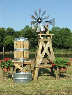 Rain barrel idea Water Tower/Tank With Stand Windmill idea Build base and add bicycle wheel wind catcher