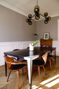 Classic Paris family dining room belonging to Cecile Roederer, founder of French children's fashion and design online shop Smallable| Remodelista