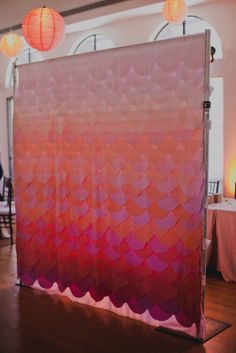 a scalloped ombre backdrop made of tissue paper, we can make this in any color wave #24