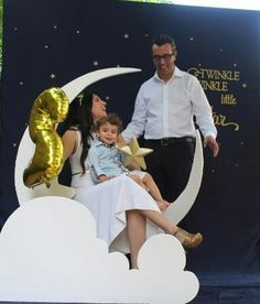 Moon PhotoBooth ; Cute photo idea...navy blue sheet background with stars, a bench to sit on, a big white moon made of styrofoam ; moon and star photo prop ; Gold + Glitter + Star themed birthday party ; twinkle twinkle little start party theme