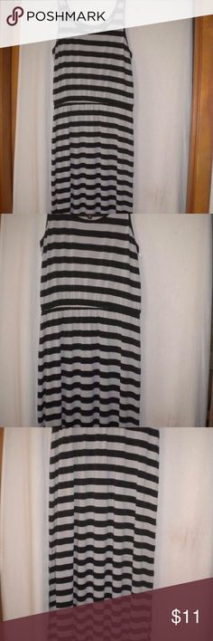 Fever Women Size Large Long Maxi Sundress Dress Barely Worn. Fever Women Size Large Sundress. Maxi.  Sleeveless. Black and gray striped pattern.  Elastic waist. Made of 95% Polyester and 5% Spandex. Chest approximately 44 inches and length approximately 60 inches. 22 inch slits along the bottom sides. Fever Dresses Maxi