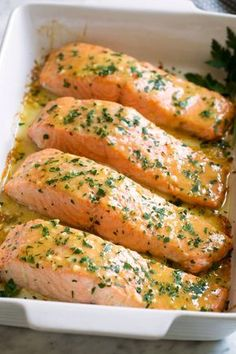 Baked Salmon with Buttery Honey Mustard Sauce - This is the easiest Baked Salmon with a sweet and tangy Buttery Honey Mustard Sauce! This recipe requires minimal effort, ONLY 5 basic ingredients, and the flavor is perfectly delicious.