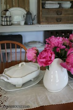 A simple vignette using peonies and collected pieces of ironstone.  I can do this.
