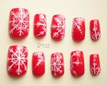 Red Snowflake Nails by RobertsPhotography