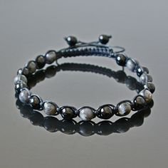 Black Tourmaline and Labradorite Handmade Beaded Crystal Mens Anklet Libra Capricorn October Birthstone Surfer Jewelry. This men's anklet can be worn on bare skin for a trendy look or discreetly underneath the clothes by those who enjoy men's crystal jewelry but do not wish other people to be aware of that. This beaded anklet will also add a nice touch to a beach wedding outfit. The anklet is made with 8 mm natural Black Tourmaline and Labradorite round stone beads, strung on a waxed…