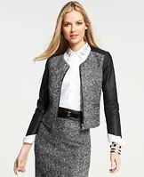 "Faux Leather Sleeve Tweed Jacket - Give your 9-to-5 wardrobe a seriously stylish upgrade with this fashion forward jacket, matching richly textured tweed with sleek faux leather at the sleeves and sides. Add a bit of bling and chic ankle boots to take your look from conference room to cocktails. Jewel neck. 3/4 sleeves. Exposed metal zip front. Front welt pockets. Lined. 20"" long."