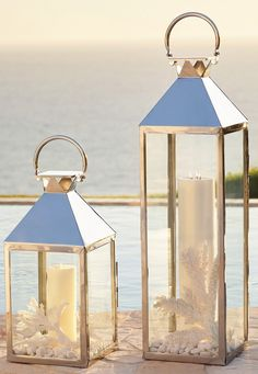 With timeless, transitional styling and an antiqued gold finish proven to withstand the elements without corrosion, the Quincy Outdoor Lanterns brighten outdoor spaces with the sophisticated glow of candlelight wherever they are placed. Diy Old Books, Old Book Crafts, Floor Lanterns, Lanterns Decor, Glass Hinges, Family Photo Frames, Romantic Room, Green Rooms, Beveled Glass