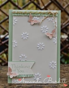 handmade card ... vellum layer over soft green ... frosted embossing technique for little daisies  .... three bitty butterflies with wings up ... like it!