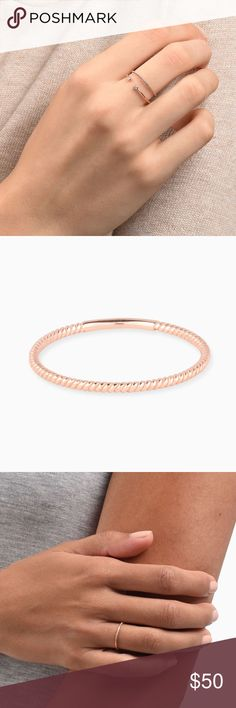 Mejuri Minimalistic Twist Ring Authentic 14K solid rose gold in size 4 :) Brand new, got it as a gift but it doesn't fit.  This is a twist on a good old classic (get it). The 1.3 mm band makes it easy to wear on a daily basis, and the twisted pattern is a pleasant surprise. It is handcrafted in 14k solid gold making it easy for it to withstand your everyday. DETAILS - Made in 14k solid rose gold, the alloy gives our pieces its beautiful, subtle hue. - Textured band. - Band thickness 1.3 mm…