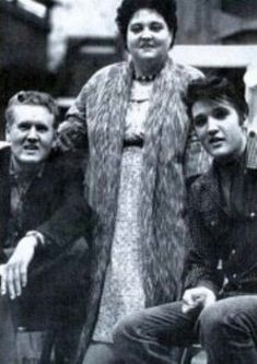 Elvis with his parents.