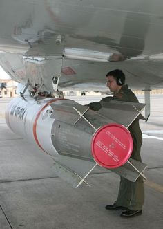 "Okinawa, Japan (Feb. 17, 2005) – Lt. Cmdr. Alan Marblestone checks a MK-65 Quickstrike mine, during an aircraft preflight on a P-3C Orion belonging to the ""Fighting Tigers"" of Patrol Squadron Eight (VP-8). The MK-65 Quickstrike mine is a shallow-water, aircraft-laid mine used primarily against surface ships. VP-8 is home-based in Brunswick, Maine, and is currently on deployment to Okinawa, Japan. Navy Day, Go Navy, Brunswick Maine, Navy Military, Okinawa Japan, Military Aircraft, Air Force, Aviation, Space"