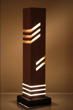 This is a modern looking decorative table light made from wood (cedar) diameter acrylic rod and a steel base.