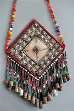 Ersari Turkoman Gonzuk on padded back, silver with thimbles and beaded fringe. info@singkiang.com  Singkiang.com
