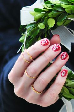 Get festive for the holidays with this DIY Abstract Christmas Tree nail art manicure topped with glitter!