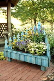 Great for a corner in yard! Picket Fence Planter, so cute! Other inexpensive planters too - LINK HAS BEEN FIXED - upcycle repurpose fence planter DIY pb