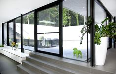 Designed by Architects DMOA, these beautiful  doors are made  by Reynaers at Home. Photo taken in Belgium.