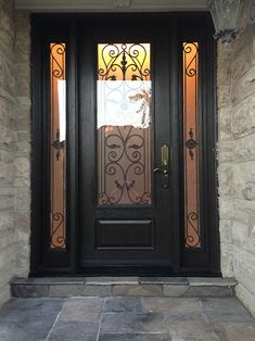 Woodgrain Wrought Iron Front Door with 2 Side lites installed in Richmond Hill  by windowsanddoorstoronto