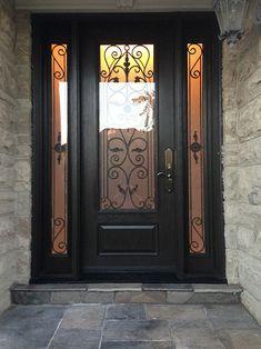 Woodgrain Wrought Iron Front Door with 2 Side lites installed in Richmond Hill  by windowsanddoorstoronto