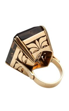 This statement gold cocktail ring dates back to the 1940's and features a large, emerald cut smoky quartz stone