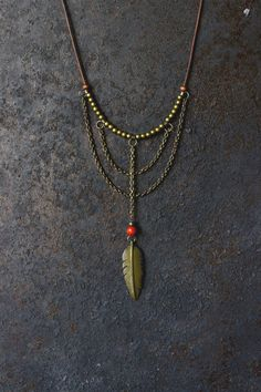 Ananke Jewelry Feather necklace (leather + beads). Tribal necklaces are very popular and trendy, as well as the boho jewelry fashion. Great as a Christmas gift for the loved ones, or just for free spirits who like Bohemian, hippie look and unique handmade jewelry. You are very welcome to visit Ananke Jewelry online Etsy shop and find more unique necklace designs and gift ideas: anankejewelry.etsy.com