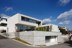 This modern two-storey residence designed in 2013 by So1architect is located in the Japanese city of Nishinomiya.