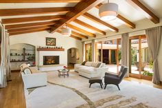 Beautiful vaulted ceilings with clean and sharp furniture to compliment the wood.