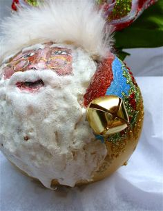 Hand Painted Santa wth Bell Glass Ornament. $75.00, via Etsy.