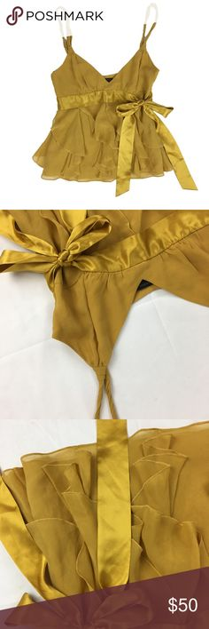 Bcbg mustered silk top **** IF YOU THINK OUR AFFORDABLE PRICES ARE TOO HIGH FOR YOU, MAKE A REASONABLE OFFER ON ANY OF THE ITEMS IN OUR STORE AND WE MAY ACCEPT IT****     - Size: silk  - Material: silk - Condition: EXCELLENT, like new  - Color: mustered  - Pockets: n/a - Lined: yes - Closure: zipper  - Pair with:    *Measurements:   Bust:  WAIST: Length:  SLEEVE: Rise: Inseam:   * The more you buy the more you save. Feel free to ask any questions. Thank you for stopping by. * BCBGMaxAzria…