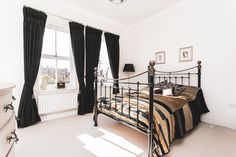Four double bedroom, three bathroom, three reception townhouse set over three floors. This stunning property is stylish and immaculate throughout with an abundance of natural light. Bedroom design. Black and white bedroom. Double bedroom ideas. White carpet. Carpet floor. #bedroominspo