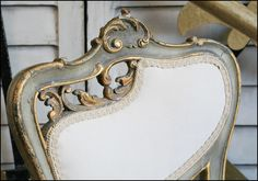 Gold/Bronze gilded chair with gray finish.  Love this.