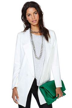 Live large in this crisp ivory boyfriend blazer featuring a single button closure and long notched lapels.