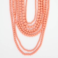 """As seen on ShopDesignSpark.com  Layer into spring.    -Plastic coral beads. Lobster clasp  -15-19""""L  -Imported"""
