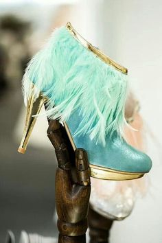 Love these Aqua boots with gold heels, and aqua feathers.