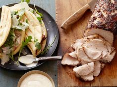 Peppered Pork and Parmesan Flatbread Sandwiches : Amy oven-roasts a gorgeous pepper-crusted pork loin for sandwiches, skipping right to the leftovers. Homemade flatbread, fresh Parmesan and a garlic-lemon aioli meld beautifully with the roast meat.