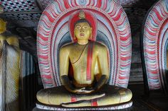 Statue of meditating Buddha on the second cave of the golden temple of Dambulla, Sri Lanka Golden Temple, Buddha Meditation, Tour Operator, World Heritage Sites, Buddhism, The Rock, Sri Lanka, Cave, Traveling By Yourself