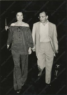 Mrs. Jacqueline Bouvier Kennedy Onassis and an unidentified male
