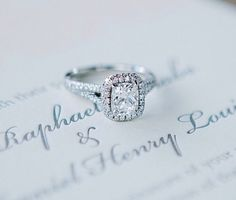 Split shank cushion engagement ring. This would be perfect without the halo and with a bigger solitaire rock instead