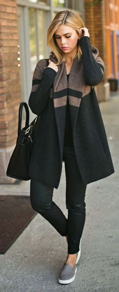 Chic black coat with taupe striped accent.