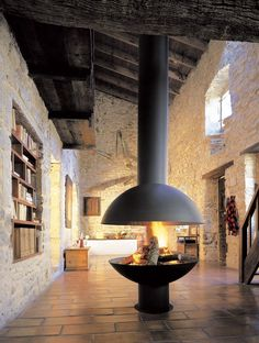Suspended fireplace in stone foyer | Rustic Home | Hygge | Fireplace Inspiration | Fireplace Dreams | Amazing Fireplaces |The Cashmere Cottage | TheCashmereCottage.com
